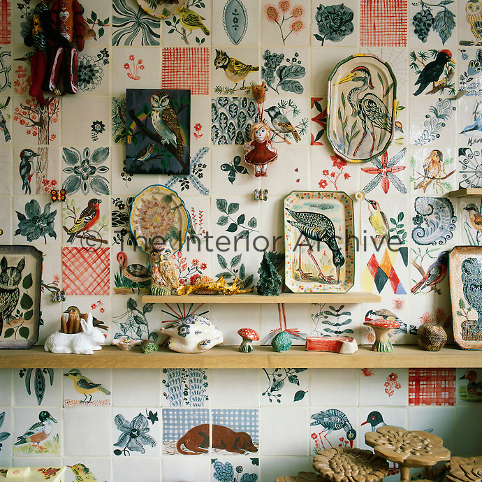 The sitting room has a feature wall comprising a striking piece of tiled artwork