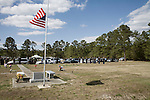 April 15, 2008. Teachey, NC..Funeral services were held for National Guard Staff Sgt. Emanuel Pickett at the 1st Baptist Church in Wallace, NC., where he was a police officer.. SSgt. Pickett was killed on April 6, 2008 in Baghdad, Iraq by indirect enemy fire. He was assigned to the 1132nd Military Police Company, North Carolina Army National Guard, Rocky Mount, N.C. and is the 8th North Carolina National Guard soldier killed in the wars in Iraq and Afghanistan.. Members of the honor guard await the arrival of the funeral procession at Duplin Memorial Gardens, a cemetery in SSgt. Pickett's home town of Teachey, NC.