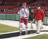 Dillon Lawrence (BU - 12) returns to the game with Larry Venis (BU - Head Athletic Trainer). - The University of Maine Black Bears defeated the Boston University Terriers 7-3 (2EN) on Saturday, January 11, 2014, at Fenway Park in Boston, Massachusetts.
