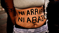 "A woman display a message in her stomach that reads "" neither up nor down "" while people take part in a march supporting prostitution in Bogota, Colombia. 25/02/2012.  Photo by Eduardo Munoz Alvarez / VIEWpress."