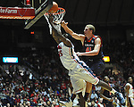 "Ole Miss' Terry Brutus (25) is fouled by Auburn center Tony Chubb (41) at the C.M. ""Tad"" Smith Coliseum on Saturday, February 23, 2013. Mississippi won 88-55. (AP Photo/Oxford Eagle, Bruce Newman)"