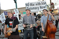 Mesa, Arizona. February 23, 2012 - As Republican candidates debated in the Mesa Arts Center, protesters including undocumented students, tea partiers, occupy movement members and Syrian president opponents, shouted slogans and held up signs and placards outside. In this photograph, The Haymarket Squares, a local band, plays a song outside the Presidential Republican debate. Photo by Eduardo Barraza © 2012