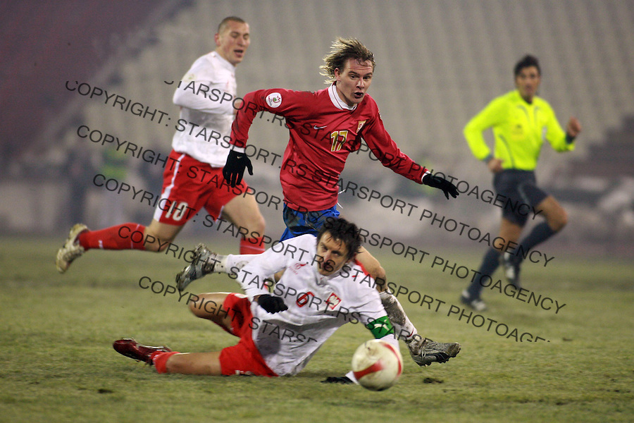 Milos Krasic of Serbia (17) runs for the ball with Bak Kamil (6) of Polamnd during UEFA EURO 2008 qualifying round match in Belgrade 21.11.2007. (credit image © photo: Pedja Milosavljevic / starsportphoto.com)