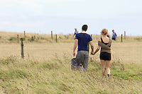 Sunday afternoon strollers follow the cliff top coastal path at Flamborough Head