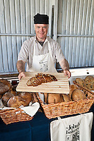 Baker Jeff Connell offers freshly baked bread from St. John's Bakery at the Brick Works farmers market.