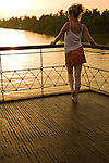 Mekong River Sunset on deck of Le Bassac  - The Mekong River is the world's tenth longest river running for over 4,000 kilometers from the Tibet through China, Myanmar, Thailand, Laos, Cambodia and Vietnam.