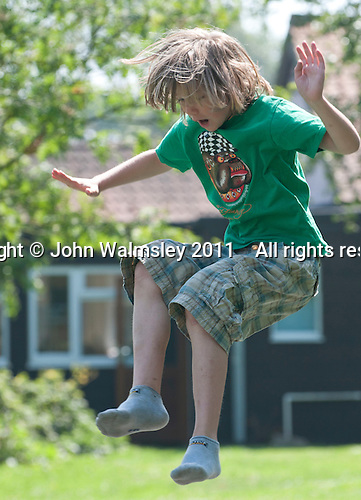 Having fun on the trampoline, Summerhill School, Leiston, Suffolk. The school was founded by A.S.Neill in 1921 and is run on democratic lines with each person, adult or child, having an equal say.  You don't have to go to lessons if you don't want to but could play all day.  It gets above average GCSE exam results.