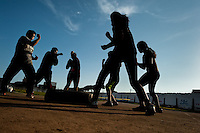 Peruvian youths practice shadowboxing while training in the outdoor boxing school at the Telmo Carbajo stadium in Callao, Peru, 4 April 2013.