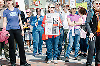 People gather in Cambridge Common for a Tax Day protest near Harvard Square in Cambridge, Mass., on Sat., April 15, 2017. The demonstrators called for President Donald Trump to release his tax returns. Trump refused to release his tax returns during the 2016 presidential campaign, in contrast to all previous major party presidential candidates, and continues to refuse to release them. The protest was part of a larger movement nationwide called Tax March.