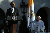 U.S. President Barack Obama (L) speaks during the arrival ceremony for Pope Francis (R) at the White House on September 23, 2015 in Washington, DC. The Pope begins his first trip to the United States at the White House followed by a visit to St. Matthew's Cathedral, and will then hold a Mass on the grounds of the Basilica of the National Shrine of the Immaculate Conception.<br /> Credit: Win McNamee / Pool via CNP
