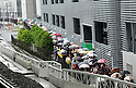 """May 22, 2012, Tokyo, Japan - Visitors wait in line for admission to the Tokyo Skytree, the worlds tallest self-standing terrestrial broadcast tower at 634 meters, which opens to the public in downtown Tokyo on Tuesday, May 22, 2012...Despite the foul weather, some 8,000 visitors turned out on the first day to see the limited but 360-degree views of the nations capital from two observation decks. On the opening day alone, the operator expected about 200,000 visitors to Tokyo Skytree Town commercial complex, which consists of the tower, a 312-tenant shopping and restaurant zone called """"Tokyo Solamachi,"""" an office building zone, an aquarium and a planetarium. (Photo by Natsuki Sakai/AFLO) AYF -mis-."""