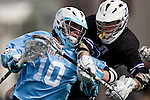 Midfielder Kevin McCormick, E12, pushes past an Amherst defender in the Tufts men's lacrosse team season opener on March 12, 2011. The defending NCAA Division III champions beat Amherst 13-9. (Alonso Nichols/Tufts University).