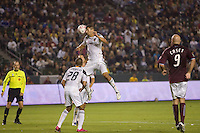 LA Galaxy defender Omar Gonzalez leaps high to clear a ball in the box. The Colorado Rapids defeated the LA Galaxy 3-2 at Home Depot Center stadium in Carson, California on Saturday October 16, 2010.