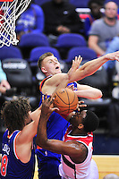 John Wall of the Wizards has his shot blocked by the Knicks. New York defeated Washington 115-104 during a NBA preseason game at the Verizon Center in Washington, D.C. on Friday, October 9, 2015.  Alan P. Santos/DC Sports Box