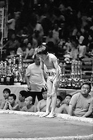 A Young Rikishi wrestler bows to his opponent before leaving the Dohyo..450 children, aged between 11-14, qualified for  the All Japan Wanpaku Sumo Tournament. The  Ryogoku Kokugikan Stadium, Tokyo, Japan.
