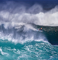 Bodyboarder on a spectacular size wave at Banzai Pipeline on North Shore of Oahu.