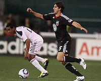 Dejan Jakevic (5) of D.C. United  challenges Miguel Lopez (25) of the Los Angeles Galaxy during an MLS match at RFK Stadium, on April 9 2011, in Washington D.C.The game ended in a 1-1 tie.