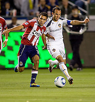Chivas USA defender Jonathan Bornstein battles LA Galaxy forward Landon Donovan. The LA Galaxy defeated Chivas USA 2-0 during the Super Clasico at Home Depot Center stadium in Carson, California Thursday evening April 1, 2010.  .