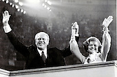 United States President Gerald R. Ford, left, and first lady Betty Ford, right, acknowledge cheers of the delegates as they arrive on the podium of the 1976 Republican National Convention at the Kemper Arena in Kansas City, Missouri on August 19, 1976.  Ford was on the podium to deliver his acceptance speech for the 1976 Republican Party nomination for President of the United States<br /> Credit: Arnie Sachs / CNP