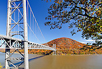 A view of the Bear Mountain Bridge in the midst of full fall colors. The hill on the far end of the bridge is known as Anthony's Nose and is a favorite with local hikers.