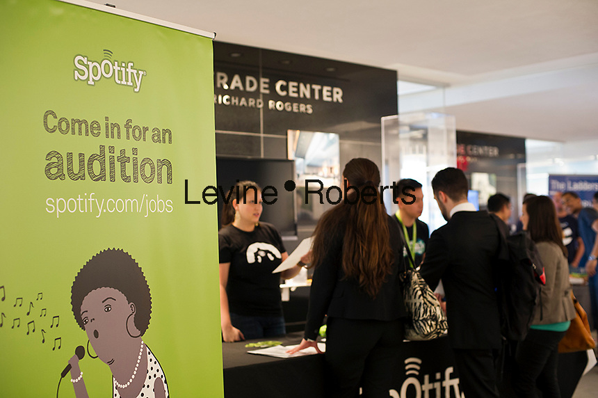 Job seekers at the Spotify booth at the Third Annual NYC Startup Job Fair in New York on Friday, April 20, 2012.  The Labor Department reported a drop in unemployment benefit applications for last week. (© Frances M. Roberts)