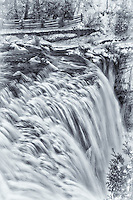 A black and white view of Webster's Falls in the winter.