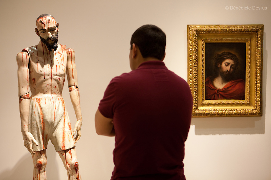 "May 14, 2011 - Mexico City, Mexico - Anonymous' Sculpture of Jesus Nazarenus and Bartolome Esteban Murillo's painting ""Ecce Homo"" (1670). Mexican billionaire Carlos Slim newly built museum Soumaya that houses his art collection which includes the second largest grouping of Rodin sculptures. It also holds many of the best known European artists from the 15th to the 20th Century, Mexican art, religious relics, historical documents and coins. Designed by Slim's 38-year old son-in-law, Fernando Romero, the six-floor, 183,000 square-foot Soumaya Museum is shaped like a wonky futuristic hourglass layered with 16 000 aluminum hexagons. The $34 million museum is part of an enormous complex including headquarters for the magnate's telecom corporations Grupo Carso and Telcel, a shopping mall and luxury apartment housing. The Museum opened to public in march 2011 and it is located in Polanco Plaza Carso of Mexico City. Photo crédito: Benedicte Desrus"