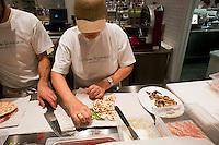 Roma 11 Giugno 2012.Apre Eataly Roma ,nell'ex Terminal Ostiense, quattro piani per una superfice  di 17 mila metri quadri,  ristoranti, caseificio, forno del pane, l'angolo delle fritture,  bar, paninoteche, negozi di alimentari, tutto della migliore qualità italiana. La piadina romagnola.Opens Eataly former Roma Terminal Ostiense, four plans for an area of ??17 thousand square meters, ,restaurants, cheese factory, bread oven , the angle fried food, cafes, sandwich shops, food stores, with an emphasis on Italian. The flatbread
