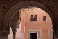 Horseshoe arch in carved stucco and column of the portico of the Patio of the Gilded Room, between the Mexuar and the Gilded Room or Cuarto Dorado in the Comares Palace, with intricately carved wall with latticed windows beyond, Alhambra Palace, Granada, Andalusia, Southern Spain. It was built under Mohammed V in the 14th century. The Alhambra was begun in the 11th century as a castle, and in the 13th and 14th centuries served as the royal palace of the Nasrid sultans. The huge complex contains the Alcazaba, Nasrid palaces, gardens and Generalife. Granada was listed as a UNESCO World Heritage Site in 1984. Picture by Manuel Cohen