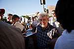 "Filmmaker George Lucas makes his way through the crowd before the American Graffiti Parade in Modesto, California, June 7, 2013. Modesto is celebrating the 40th anniversary of the film ""American Graffiti"", with a parade headed up by native son, filmmaker George Lucas."