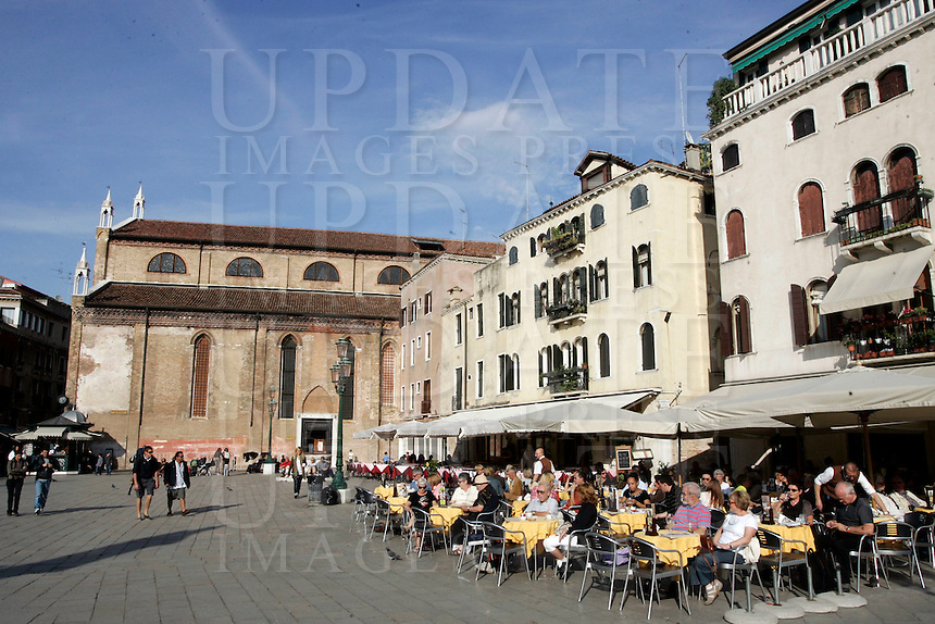 Una veduta di Campo Santo Stefano, con i caffe' all'aperto e la chiesa sullo sfondo.<br /> A view of Campo Santo Stefano, with cafes and the church on background, in Venice.<br /> UPDATE IMAGES PRESS/Riccardo De Luca