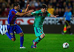 Levante's Xavi Torres (L) vies for the ball with FC Barcelona's Lionel Messi (R) during the Spanish league football match Levante UD vs FC Barcelona on April 14, 2012 at the Ciudad de Valencia Stadium in Valencia. (Photo by Xaume Olleros/Action Plus)