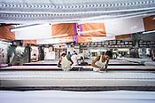 Local Rajasthani printer prints designs on fabric using wooden blocks at a factory in Jaipur, Rajasthan, India.