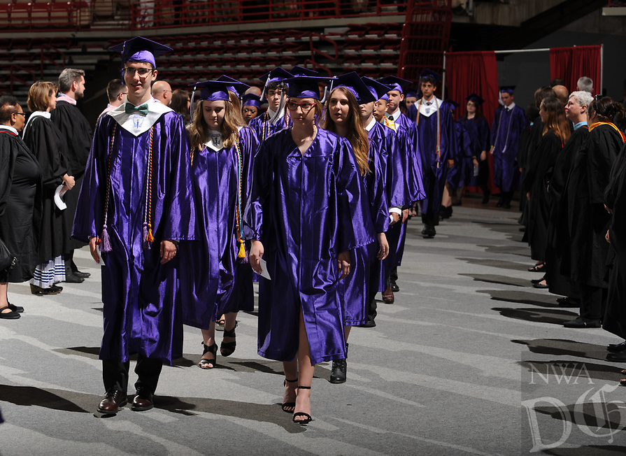 NWA Democrat-Gazette/ANDY SHUPE<br /> Students, staff and faculty take part Thursday, May 18, 2017, in Fayetteville High School's commencement exercises in Bud Walton Arena.. Visit nwadg.com/photos to see more photographs from the ceremony.