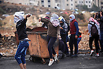 Palestinian protesters throw stones at Israeli troops during clashes near the Jewish settlement of Bet El, near the West Bank city of Ramallah, October 29, 2015. Israeli security forces shot dead two Palestinian assailants in the occupied West Bank on Thursday, police and the army said, as a month-long spate of stabbing attacks showed no signs of abating. Photo by Shadi Hatem