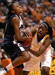KNOXVILLE, TN--07 JANUARY 2005- 010706JS01-<br /> UConn's Renee Montgomery gets the ball taken away by Tennessee's Shanna Zolman during their 89-80 loss Saturday at the Thompson-Boling Arena in Knoxville, Tennessee. <br />  --Jim Shannon Republican American--UConn; Tennessee; Thompson-Boling Arena; Knoxville; Tennessee are CQ