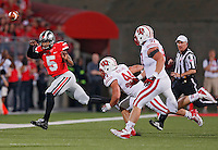 Ohio State Buckeyes quarterback Braxton Miller (5) throws the ball away because of pressure from Wisconsin Badgers linebacker Chris Borland (44) and Wisconsin Badgers defensive end Konrad Zagzebski (91)at Ohio Stadium on September 28, 2013.  (Chris Russell/Dispatch Photo)