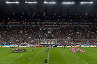 The New Zealand team perform the haka as the Tonga team opposite them perform their Sipi Tau. Rugby World Cup Pool C match between New Zealand and Tonga on October 9, 2015 at St James' Park in Newcastle, England. Photo by: Patrick Khachfe / Onside Images