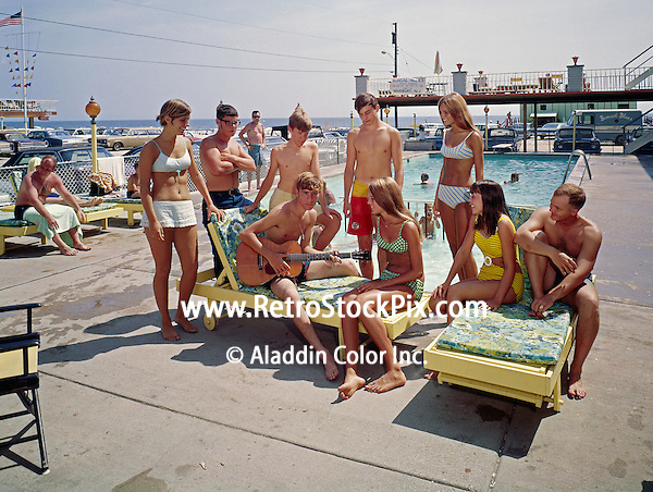 Teenagers playing guitar with friends around the Gondolier Motel pool.1960's