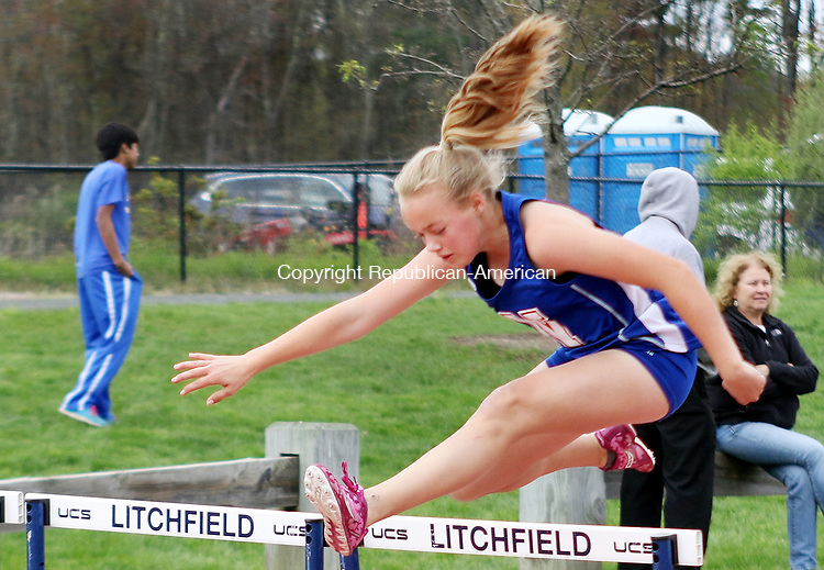 LITCHFIELD CT. 09 May 2017-050917SV13-Cassandra Barbino of Nonnewaug High competes in the 110 Hurdles during a track meet against Litchfield High and Gilbert High in Litchfield Tuesday. <br /> Steven Valenti Republican-American