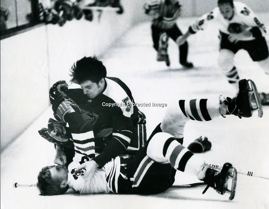 Seals Carol Vadnais lands a smash in the face of Black Hawks Keith Magnuson. (photo 1969 by Ron Riesterer)