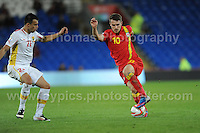 Cardiff City Stadium, Friday 11th Oct 2013. Aaron Ramsey of Wales battles with Mirko Ivanovski of Macedonia during the Wales v Macedonia FIFA World Cup 2014 Qualifier match at Cardiff City Stadium, Cardiff, Friday 11th Oct 2014. All images are the copyright of Jeff Thomas Photography-07837 386244-www.jaypics.photoshelter.com