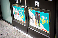 Advertising for electronic cigarettes on the entrance to a 7-Eleven convenience store in New York on Friday, may 31, 2013. The alternative to smoking releases water vapor and is advertised as safer being tobacco-free. (© Richard B. Levine)