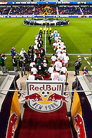 D. C. United and New York Red Bulls players take the field. D. C. United defeated the New York Red Bulls 1-0 (2-1 in aggregate) during the second leg of the MLS Eastern Conference Semifinals at Red Bull Arena in Harrison, NJ, on November 8, 2012.