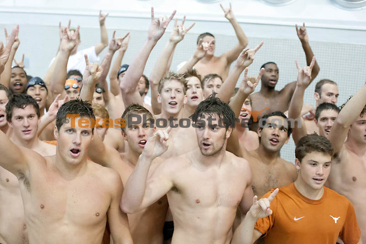 The UT Men's Swim and Dive team sings the Eyes of Texas after the Orange and White meet.