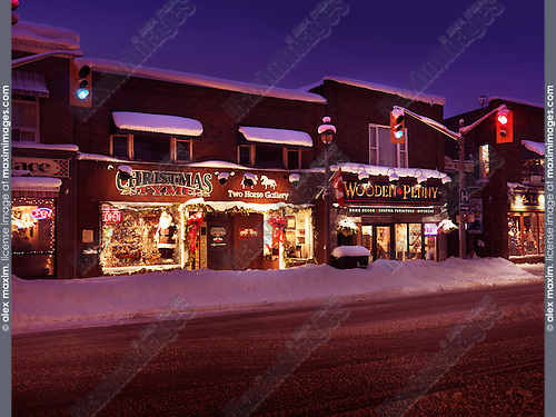 Pretty little Canadian town before Christmas, downtown of Huntsville, shops on Main street, town center, Muskoka, Ontario, Canada 2016 snowy winter scenery. Christmas Tyme, Two Horse Gallery, Wooden Penny.