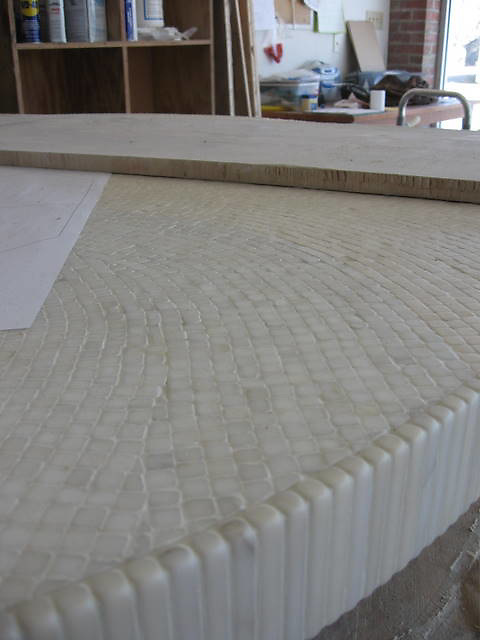Custom Poseidon table top in creams honed and pillowed