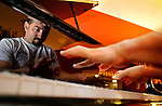 November 13, 2003 -Central City Concern client John Prentice takes in some practice at Michele's Pianos. An accomplished musician, the management there allows him to play on a very expensive and finely crafted Bosendorfer Model 290 Imperial....KEYWORDS:   homeless, rehab, street