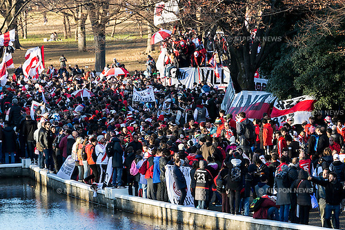 River Plate fans chant and wave flags to support their soccer team in Yoyogi Park on December 19, 2015, Tokyo, Japan. Thousands of Argentine soccer fans came to Tokyo to support their team on the final match (FC Barcelona vs River Plate) in the FIFA Club World Cup Japan 2015 to be held on December 20 in Yokohama. (Photo by Rodrigo Reyes Marin/AFLO)