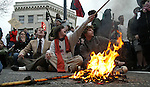 March 20, 2003 - Protesters shout out anti-war, anti-government remarks while burning flags at the intersection of W. Burnside and 2nd Ave.